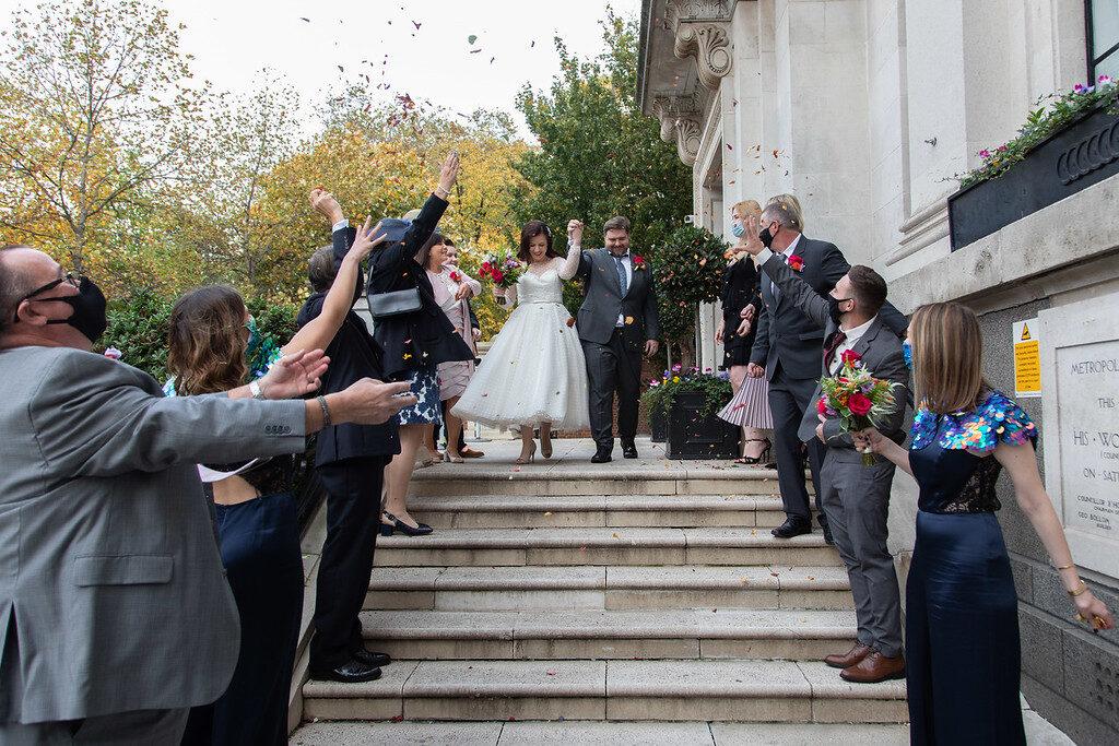Just Married London Islington Borough of Camden Outdoor Wedding Guests Small Gathering Confetti Wedding Dress Bride Groom